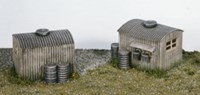 Two Lamp Huts With Oil Drums