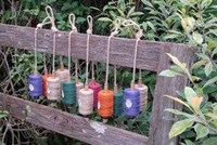 Double hanging bobbins with twine